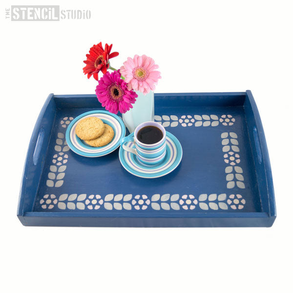 tray with coffee cups and biscuits - stencilled with dorit flower border stencil mini by the stencil studio Ltd