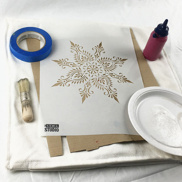 Collect the things you need to start stencilling a cushion cover with fabric paints and stencils from The Stencil Studio