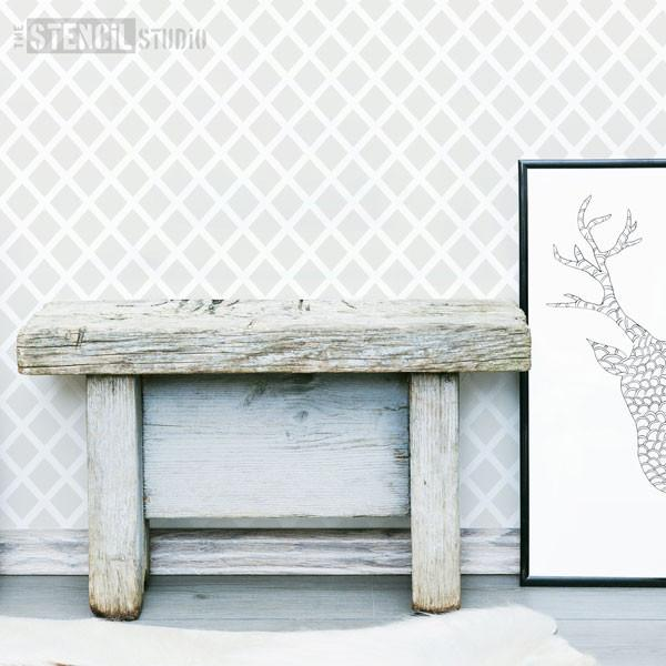 Diamonds Forever stencil featuring the S size stencil in grey in Scandi style interior with stag head framed print and wooden bench