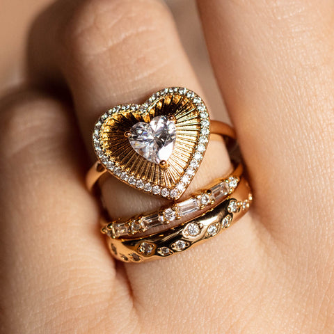 heart ring and yellow gold sparkly band rings