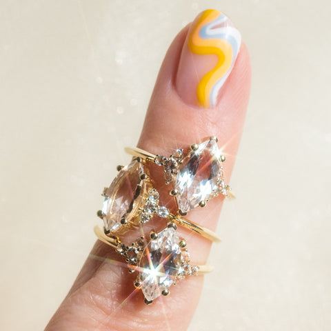 topaz yellow gold statement cocktail ring on a finger