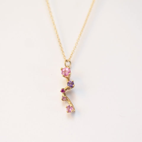 Statement necklace with pink sapphires and yellow gold
