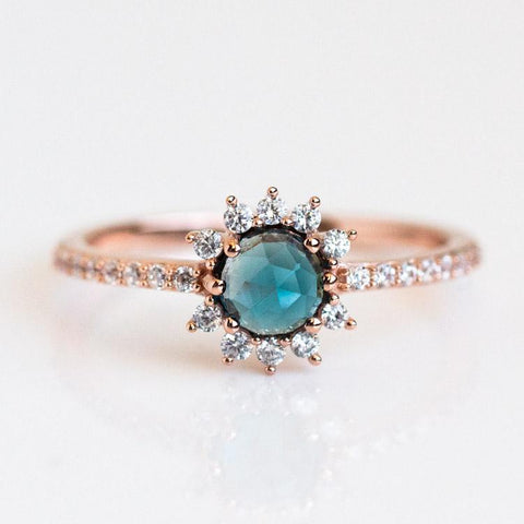 rose gold and blue stone ring