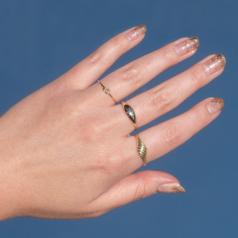 glitter nail art with solid gold rings why the sky in the background