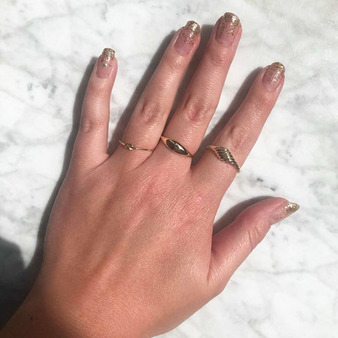 glitter nail art with solid gold rings