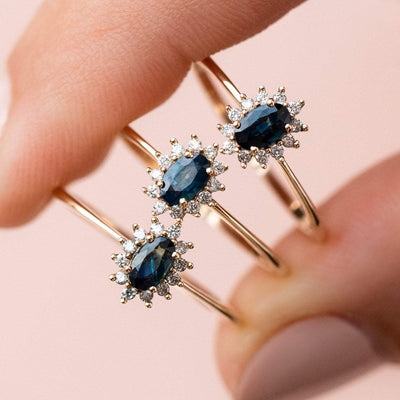 unique teal sapphire ring with diamonds