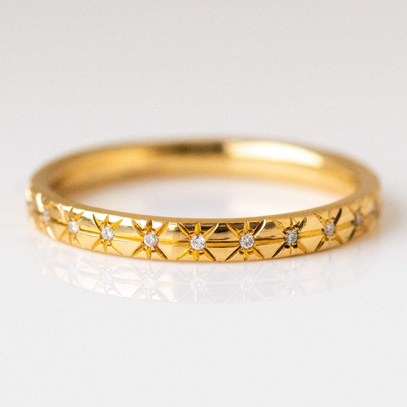 It is just a picture of Engraved Star Diamond Wedding Band