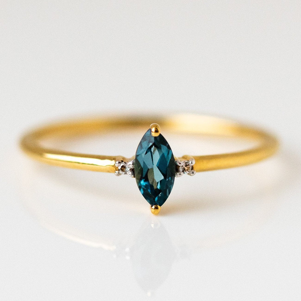 simple marquise ring with london blue topaz dainty yellow gold jewelry