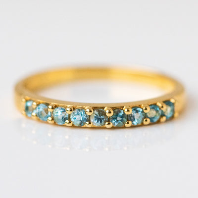 swiss blue topaz yellow gold band ring modern yellow gold jewelry