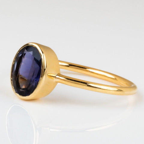 iolite oval bezel set ring yellow gold minimal modern jewelry
