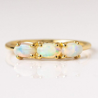 Past, Present & Future Ring with Opals rings Charlie and Marcelle