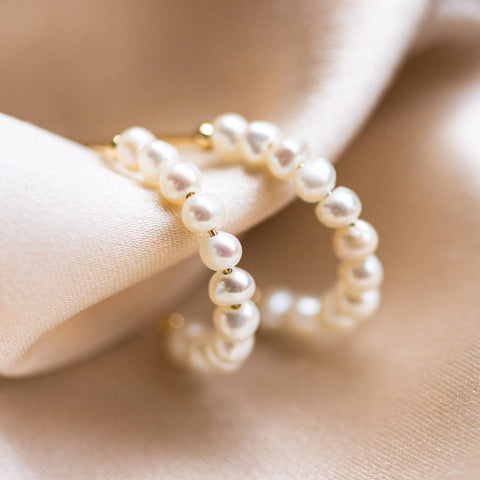 solid gold simple pearl huggie hoop earrings dainty minimal modern fine jewelry