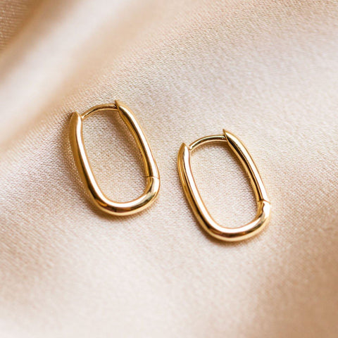 solid gold simple oval hoops dainty modern yellow gold fine jewelry