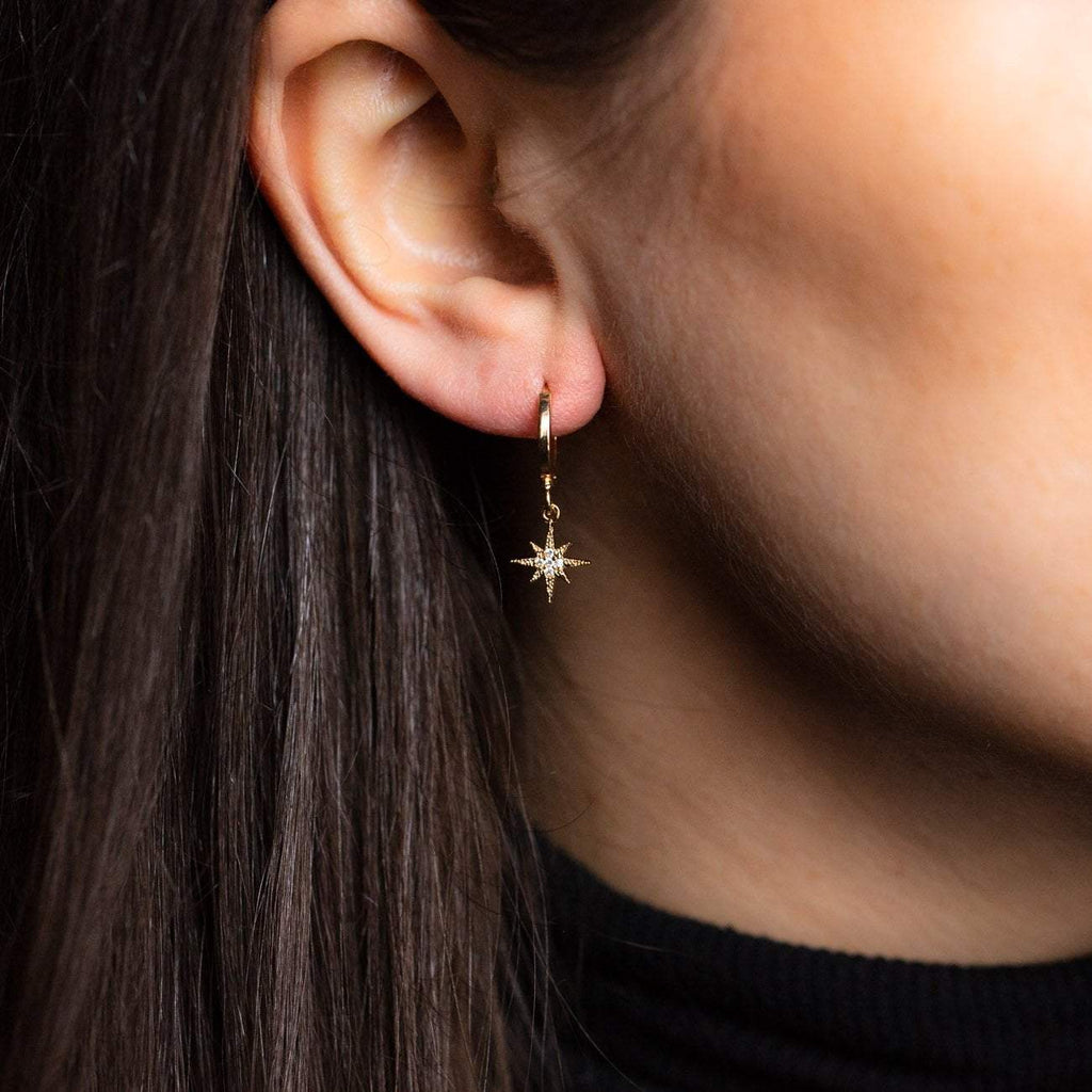 Chloe Gold mini hoop earrings moon star charms