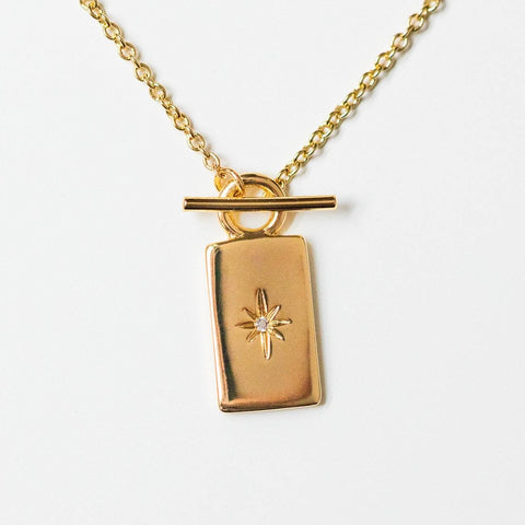 june necklace toggle yellow gold star celestial jewelry