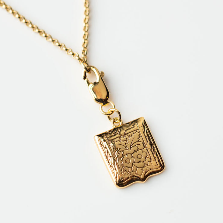 Lima Shield Charm Necklace modern yellow gold floral design minimal jewelry five and two