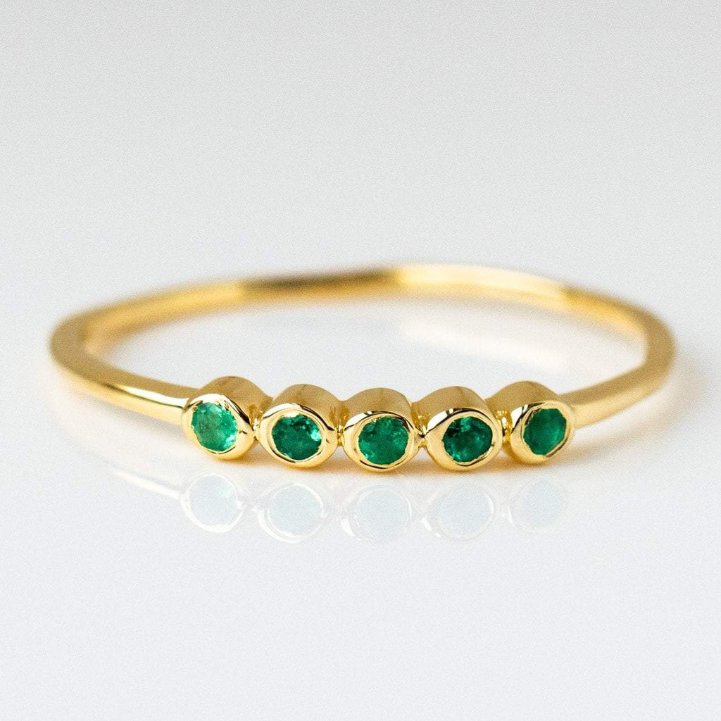 elipsis ring with emerald modern dainty yellow gold jewelry