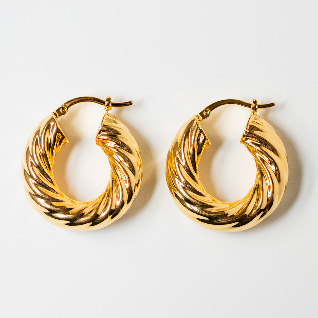 statement yellow gold hoop earrings twisted hoops