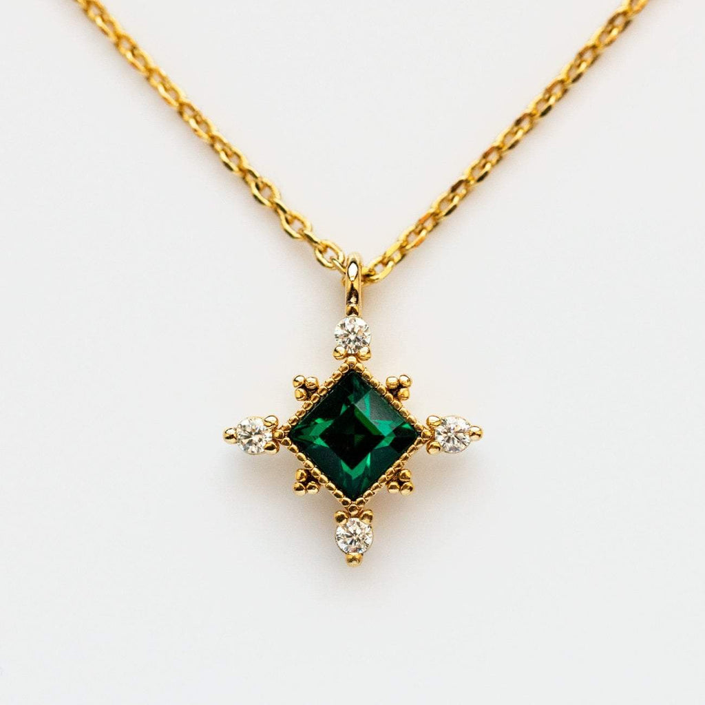 The Emerald Sierra Necklace from Lover's Tempo is vintage inspired and featured Emerald Swarovski crystal with a yellow gold chain..