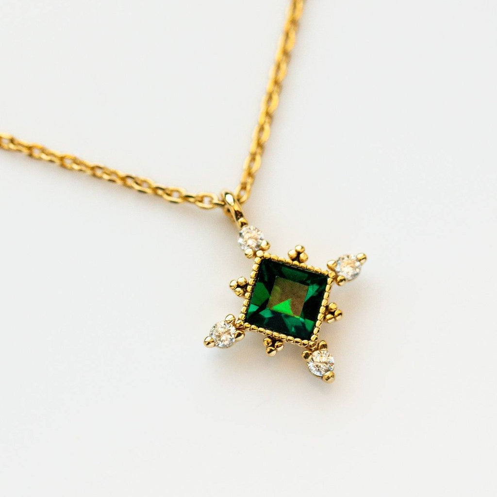 The Emerald Sierra Necklace from Lover's Tempo is vintage inspired and featured Emerald Swarovski crystal with a yellow gold chain.
