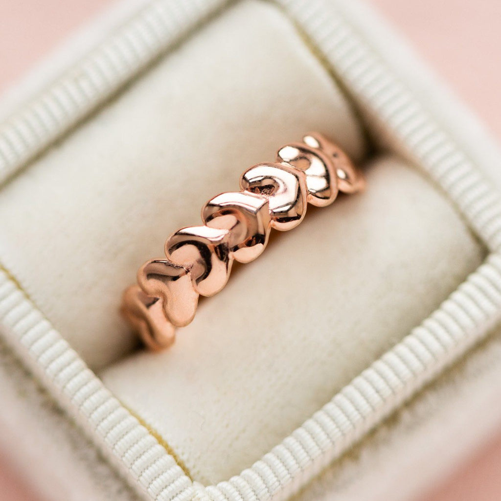 delicate heart shaped yellow gold eternity band modern jewelry
