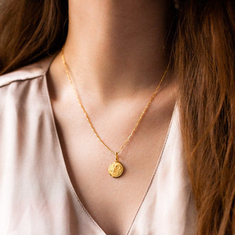 unique yellow gold horoscope pendant necklace with figaro chain