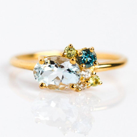 Aquamarine blue topaz peridot gold ring