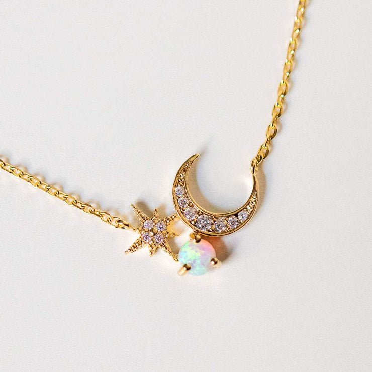 crescent moon and starburst opal necklace yellow gold celestial jewelry