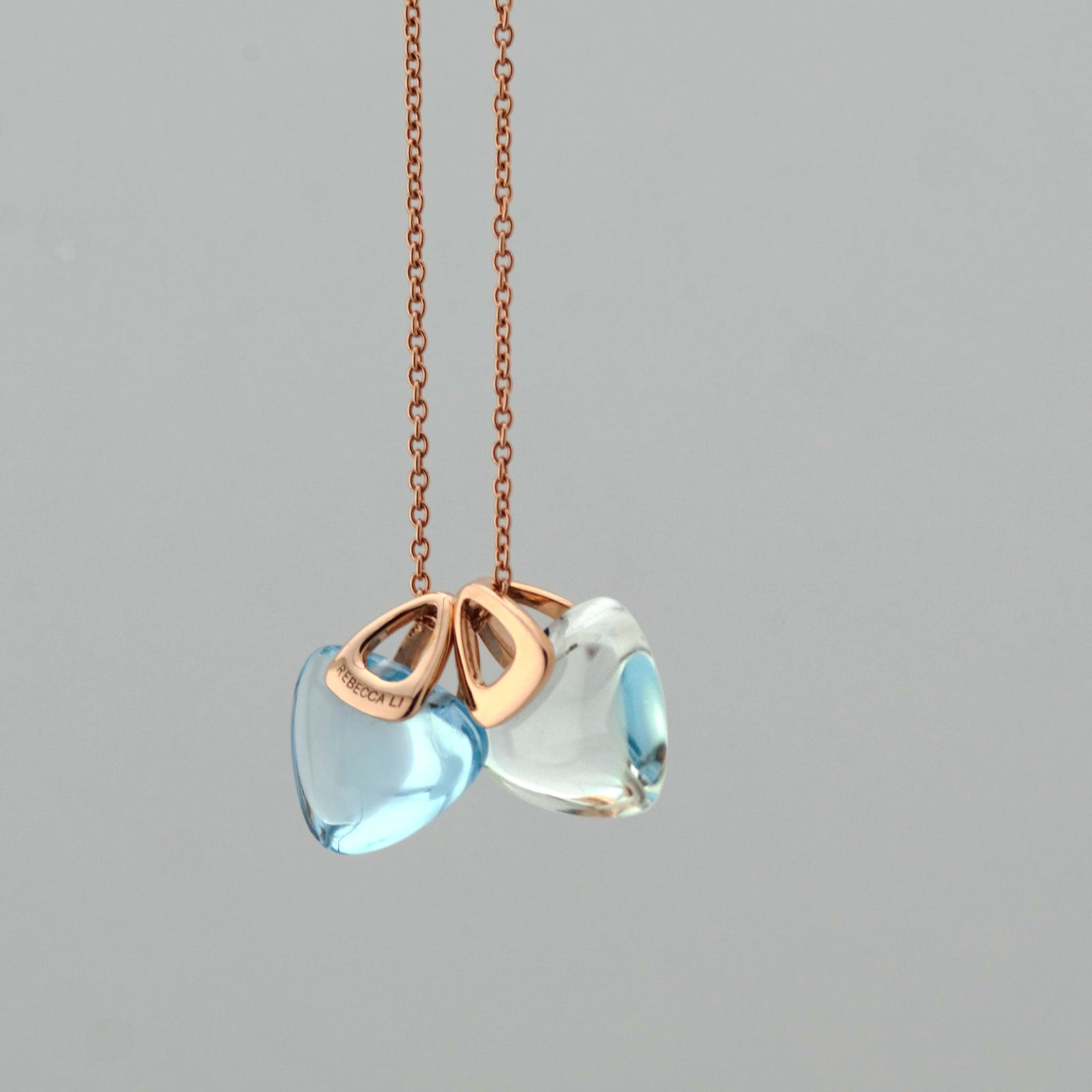 Natural rock crystal and blue topaz pendant, Rebecca Li