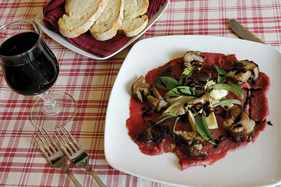Beef Carpaccio with a Warm Mushroom Salad, Rocket and Parmesan