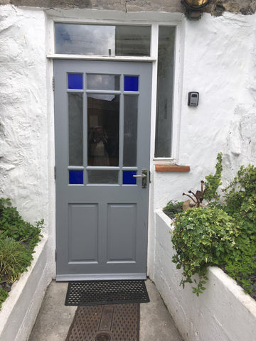 Kitchen door entrance with key safe.