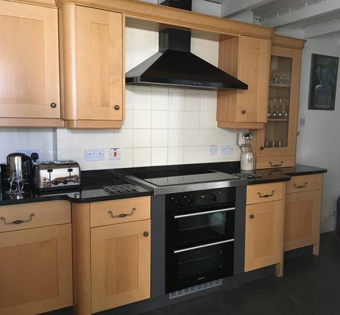 Kitchen with electric cooker and hob