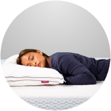 Woman sleeping on her stomach on an Endy Mattress and Pillow.