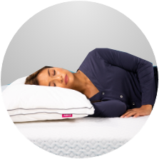 Woman sleeping on her side on an Endy Mattress and Pillow.