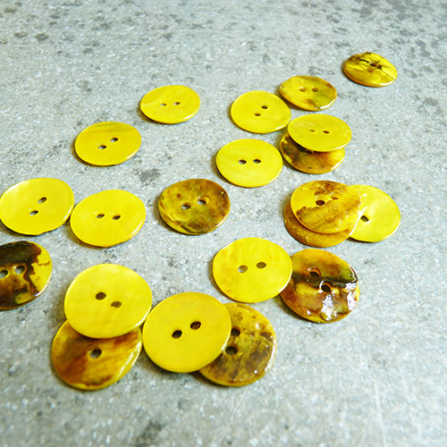 yellow shell buttons