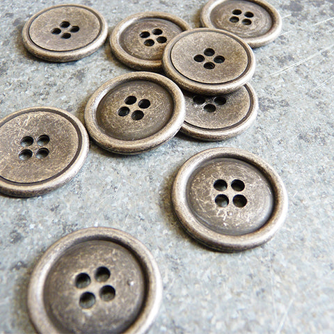 four hole antiqued silver button