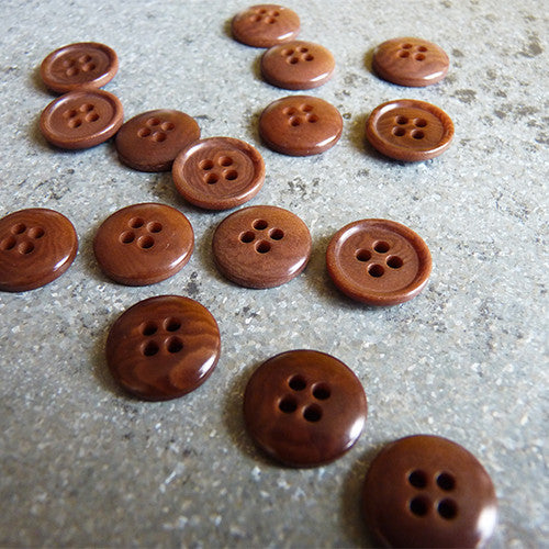 rimmed edge corozo button brown