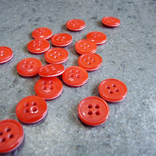 sandwiched 4 hole plastic button red white