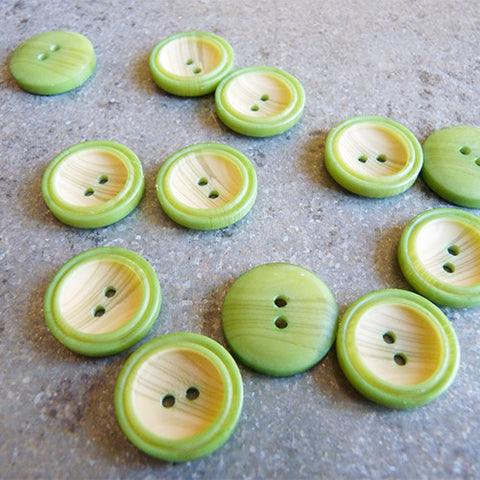 woody rimmed plastic button green 2 hole