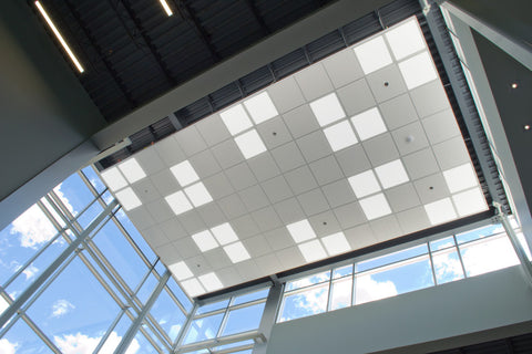 Skylight LED panels (2x2ft models) installed in a lobby