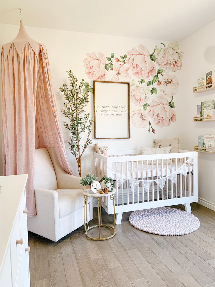 Blush Nursery with wall decal flowers for baby girl