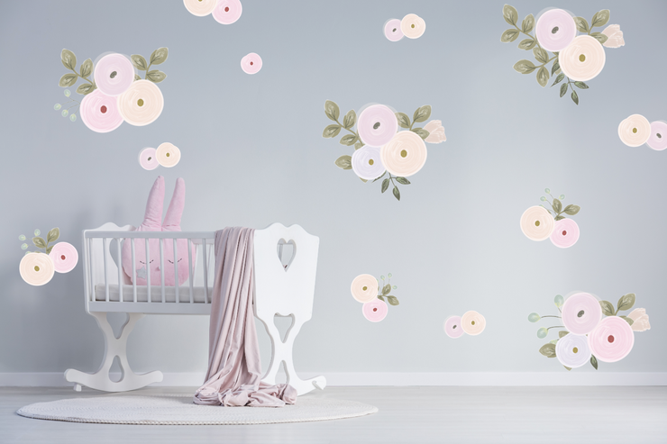 Pastel pink illustrated flowers with green leaves on a grey wall in a child&