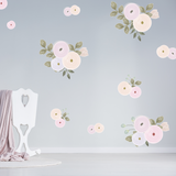 Pastel pink illustrated flowers with green leaves on a grey wall in a child's nursery.
