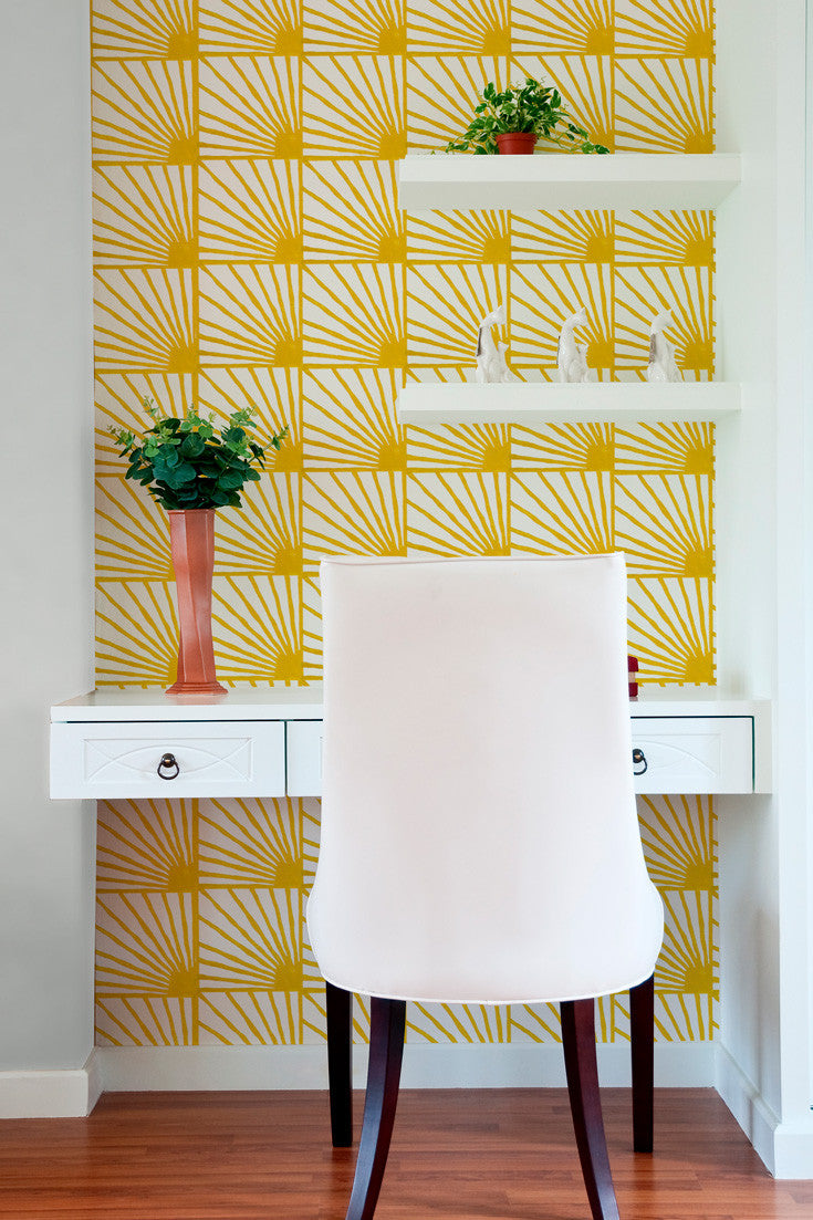 What a happy space (even if it is a small home office)! Catch Some Rays artisan hand block printed wallpaper in Saffron (yellow) by Sarah & Ruby.