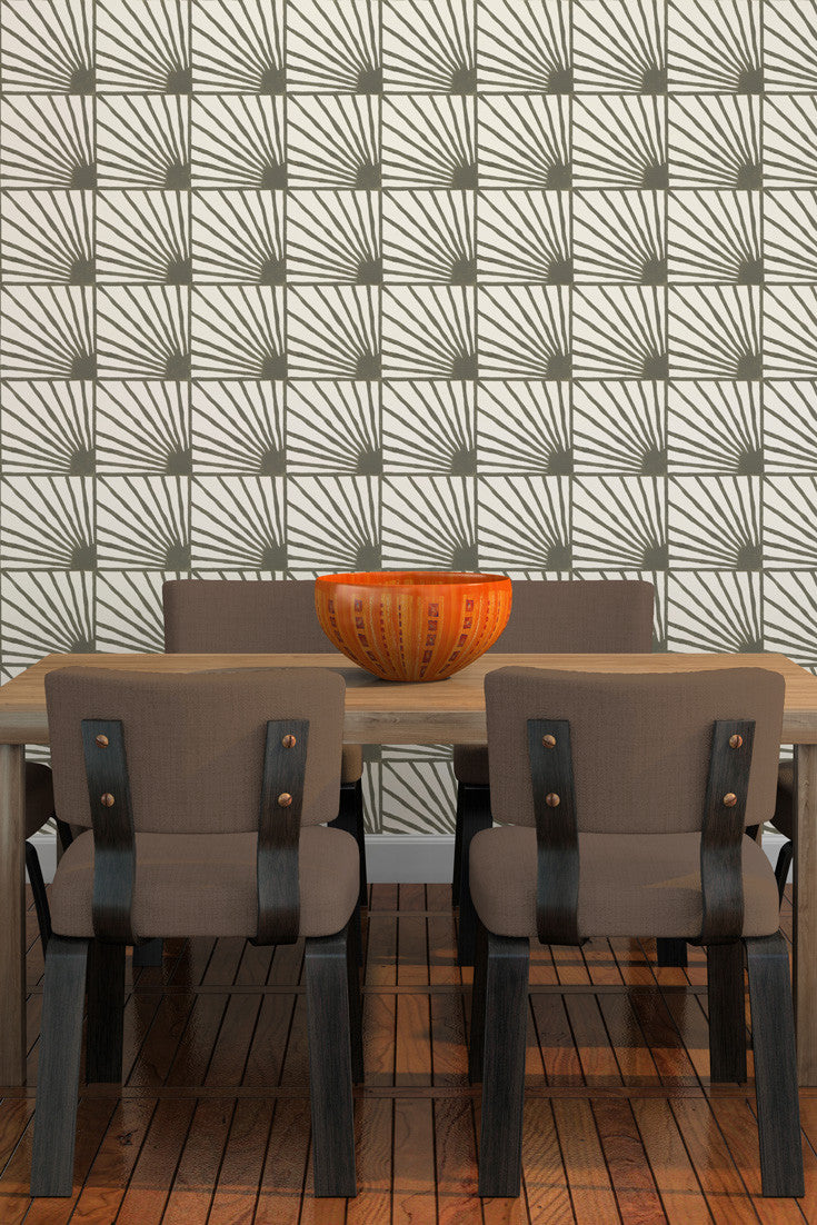 Catch Some Rays hand block printed wallpaper in Stone (gray) makes a great modern accent wall in this dining room. By Sarah & Ruby.
