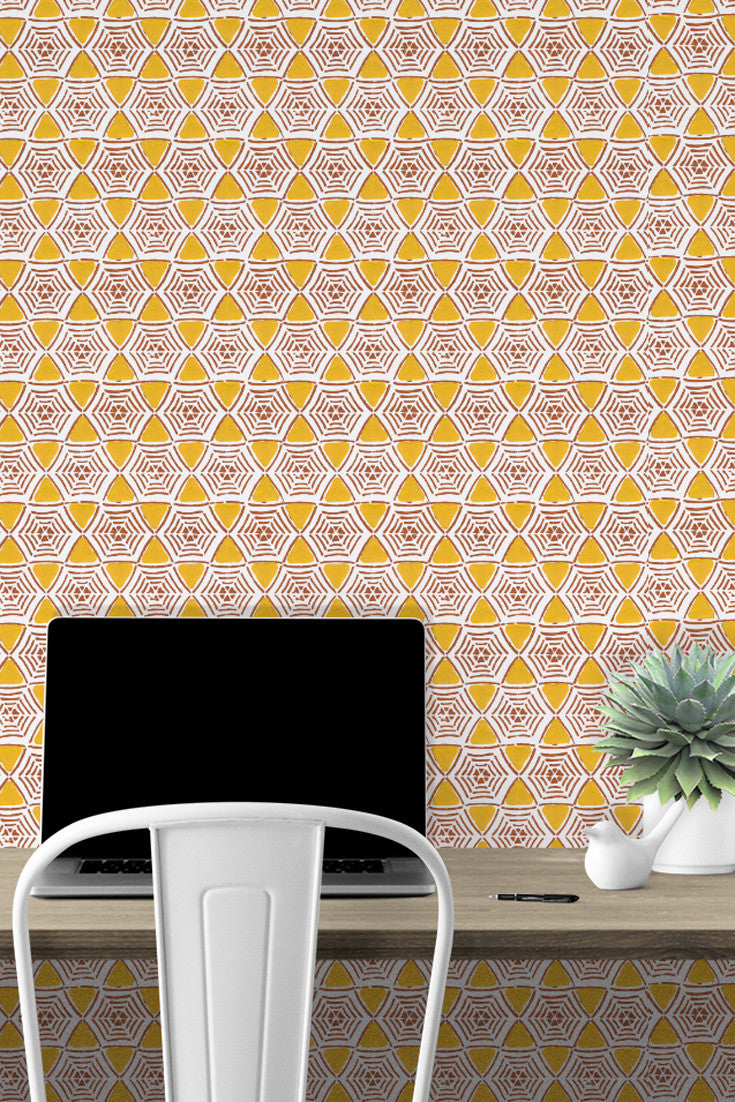 Can I work here? Caught In My Web Wallpaper in Saffron (yellow and rust) definitely livens up this home office with fun color! All hand printed. By Sarah & Ruby.