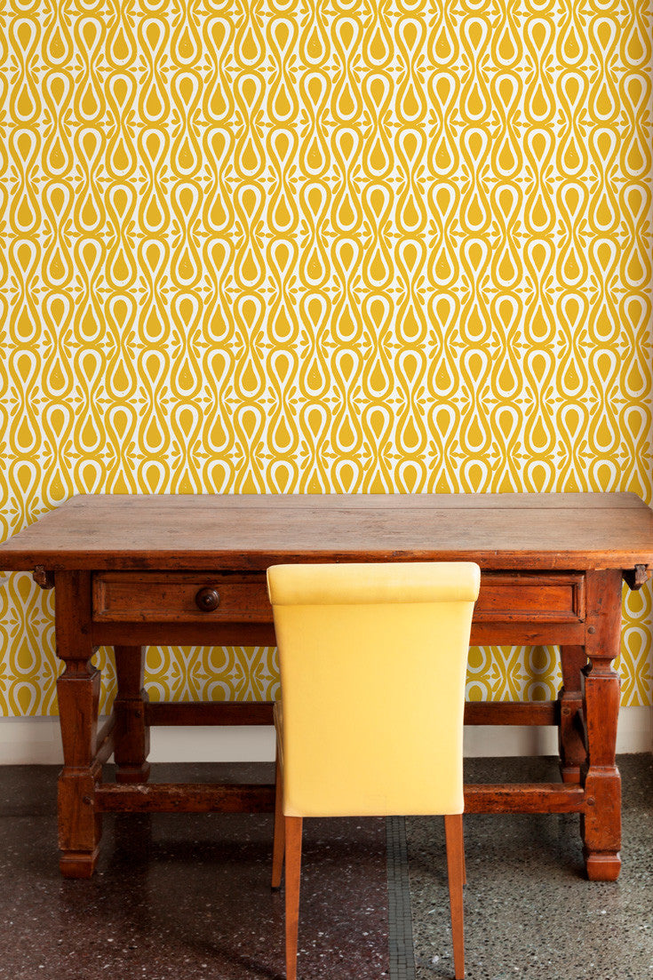 Drop On Over hand block printed wallpaper in Saffron (yellow) makes a fun, colorful statement wall in this workspace | by Sarah & Ruby