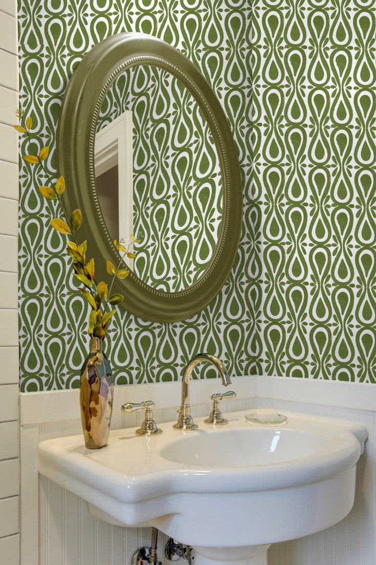 Drop on Over artisan hand block printed wallpaper in Moss (olive green) by Sarah & Ruby. Adds a great shot of color to this bathroom!