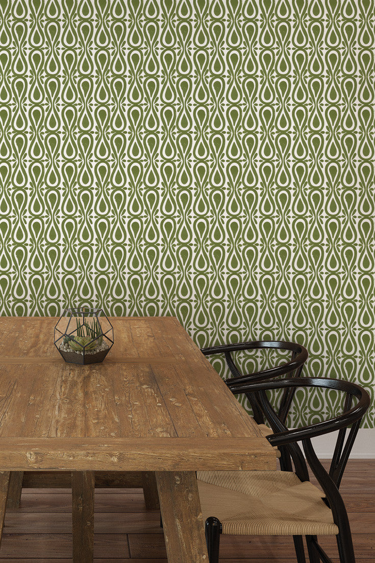 Drop On Over artisan hand printed wallpaper in Moss (olive green) by Sarah & Ruby. Boldly-Proportioned and colorful. Love the pairing with the more rustic table.