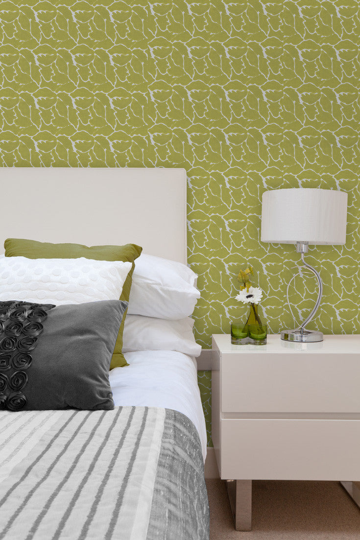 We Just Fit hand block printed wallpaper in Citron (lime green) used as a great accent wall in this bedroom. By Sarah & Ruby.